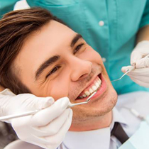 Man having dental work performed