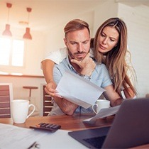 couple looking over paperwork together