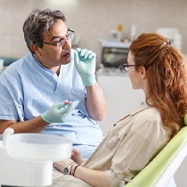 dentist explaining dental implants to a patient