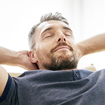 Man relaxing with hands on head